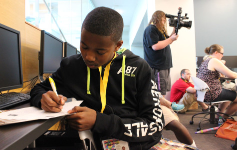 Campers practice media skills at basketball press conference