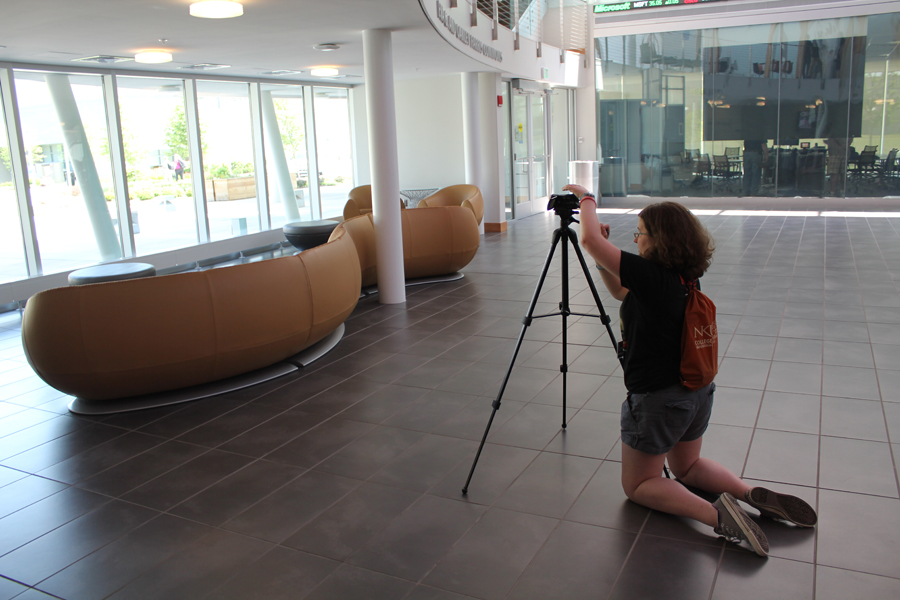 Casey Machenheimer sets up her tripod for the video scavenger hunt in the lobby of Griffin Hall.