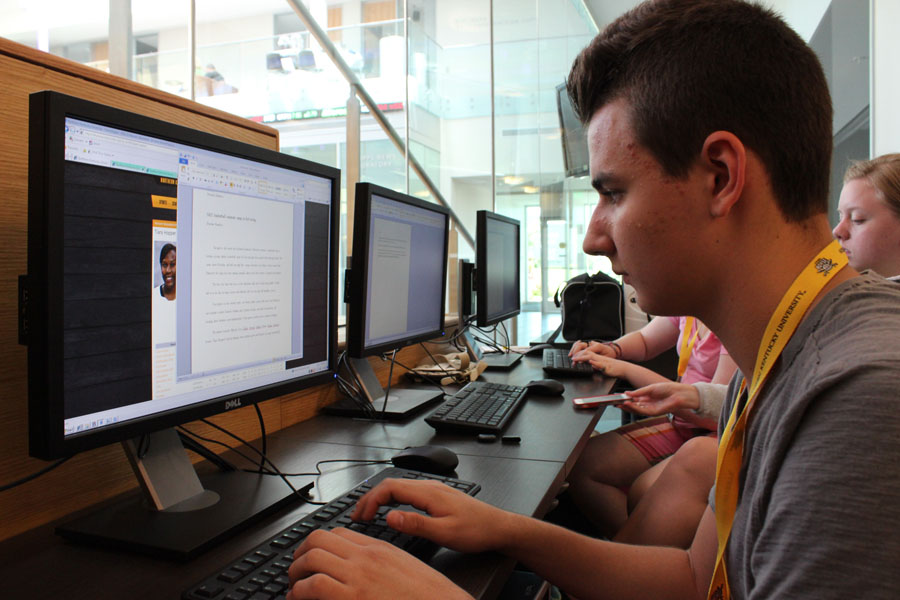 Brendan Hamilton works on his story after being on assignment at the NKU women's basketball camp.