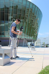 Brendan Hamilton sets up his tripod during the video scavenger hunt outside of Griffin Hall.