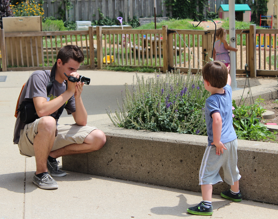 Brendan+Hamilton+takes+a+picture+of+a+child+from+NKU%E2%80%99s+daycare.+