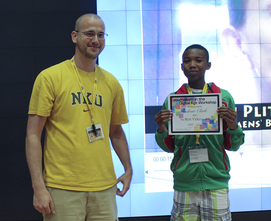 """Mentor Stephen Wilder presented Andrew Clark with the """"Best Video"""" award on the final day of the workshop. Clark won for his creative video of the women's basketball camp at NKU that he shot and edited during the week of the camp."""