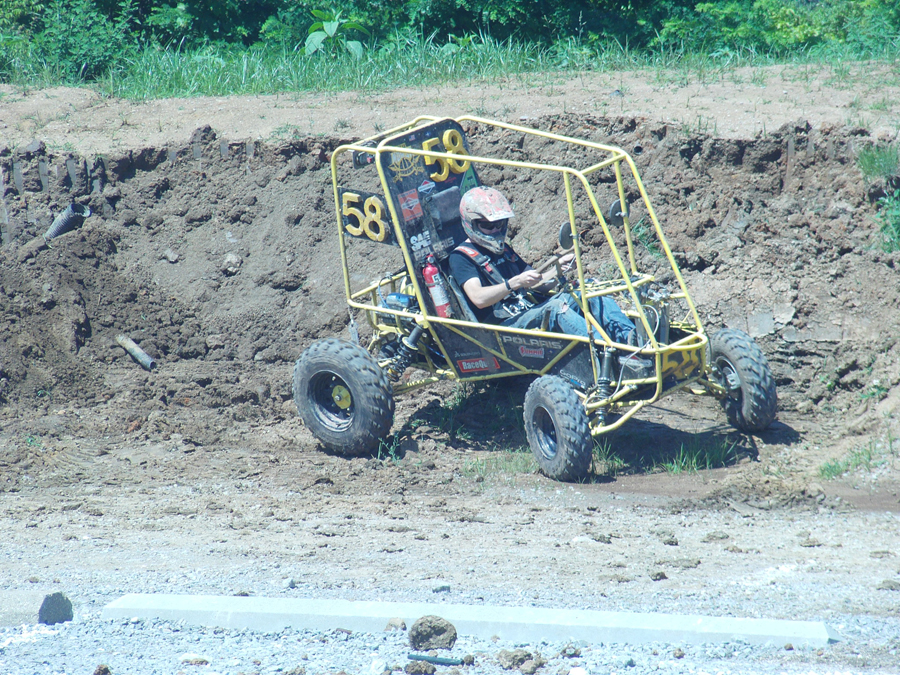 President+of+NKU%E2%80%99s+SAE+club%2C+Nathan+Rogers%2C+turns+his+wheel+in+preparation+for+another+test+run+around+gravel+parking+Lot+A+on+campus.+