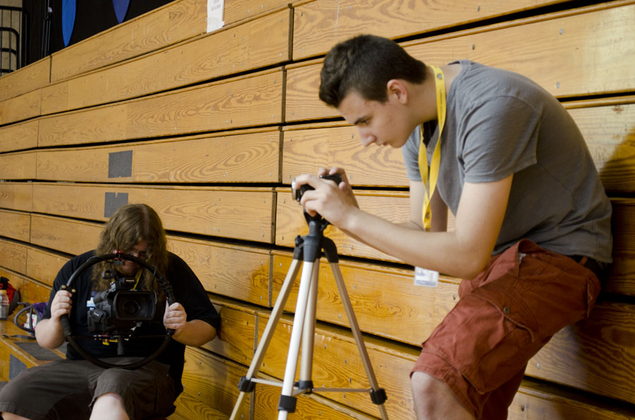 Brendan Hamilton takes video at the NKU women's basketball camp while mentor, Robert Huelsman takes video of the students on assignment.