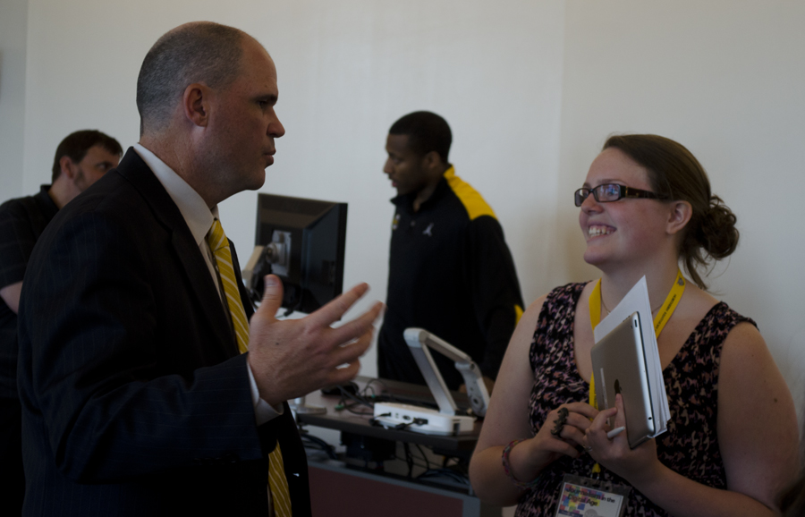 Natalie Neace talks with head coach, Dave Bezold after the press conference.