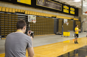 Workshop student Brendan Hamilton lines up a shot of basketball camp instructor Melody Doss.  Photo by Stephan Wilder