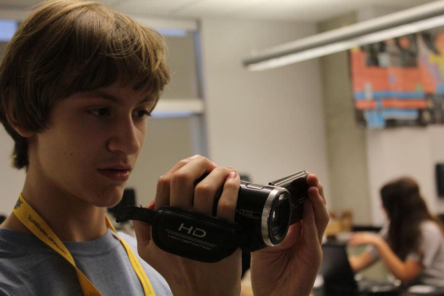 Joseph Glandorf shoots video while on assignment at the aeronautics camp.
