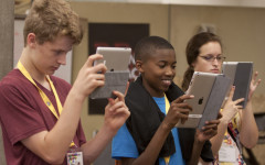 Noah Olberding, Andrew Clark, and Olivia Krauth experiment with the iPads while taking Instagram photos.