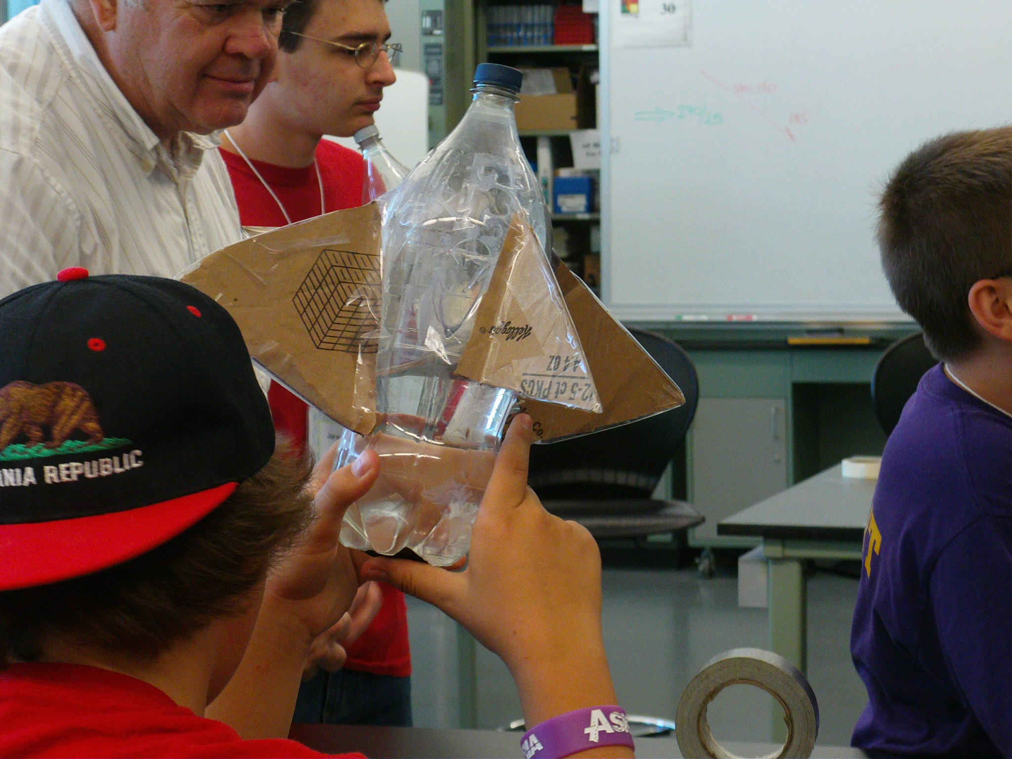 Campers build rockets out of two liter bottles which they then launch outside.