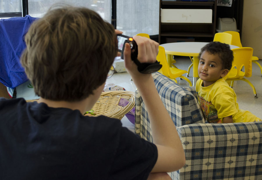 Campbell+Haynes+takes+a+picture+of+a+child+at+NKU%E2%80%99s+daycare.+