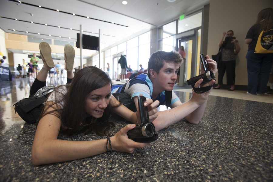 Montse Mendez and Jonah Yonker get low for the perfect shot. Photo by Bruce Crippen
