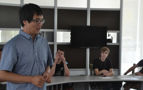 Austin Lee lectures the group on info graphics.