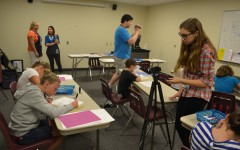 Elizabeth Juengling shoots two young artists at the Cartoon Under the Sea class.