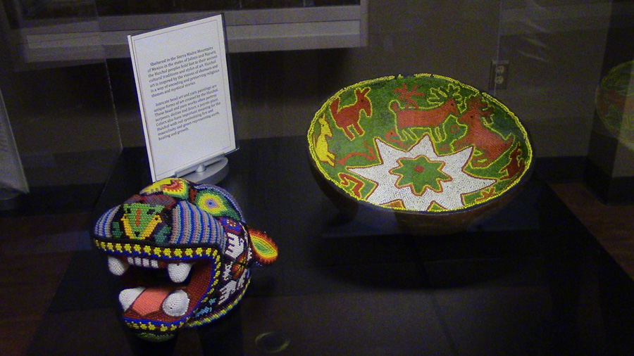 Bead art, a jaguar head (left), and a bowl (right).
