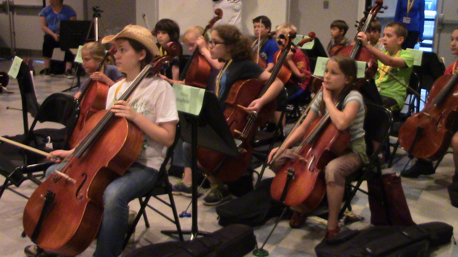 Workshop campers take part in filming and gathering materials for stories at the NKU String Camp