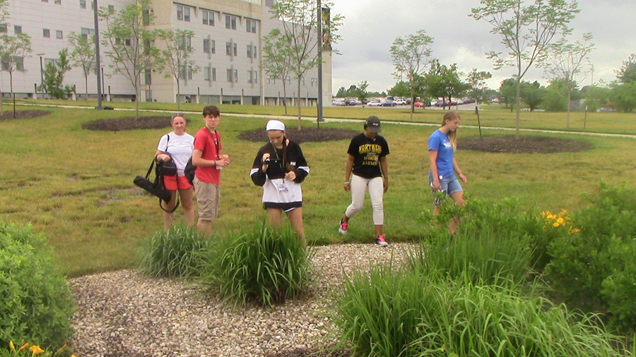 Workshop campers take part in filming and gathering materials for stories at the NKU Raingarden
