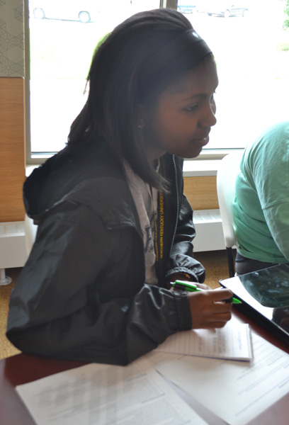 Isabela Gibson takes notes  during the press conference.