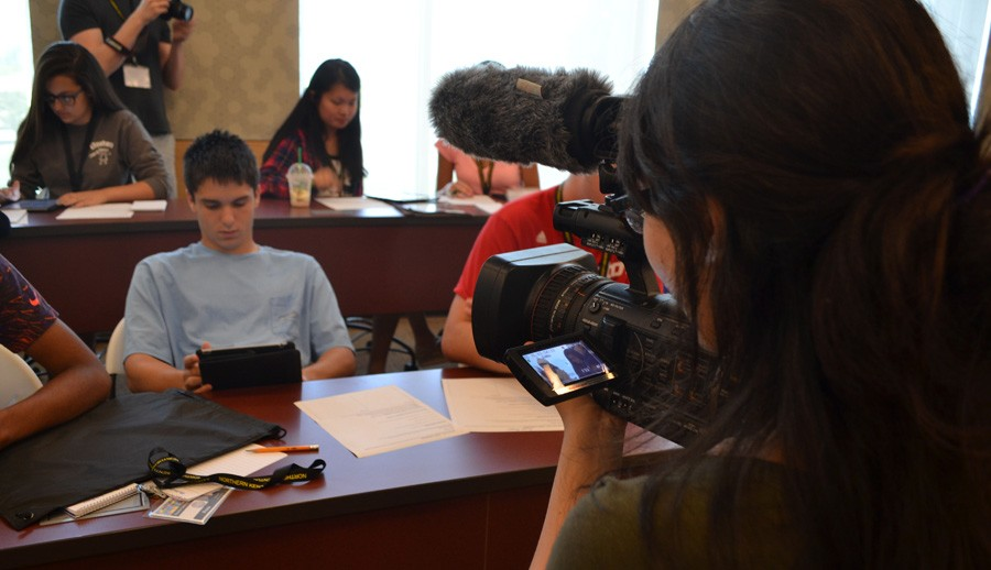 Lindsey Rudd gets some video footage of the students researching for the press conference.