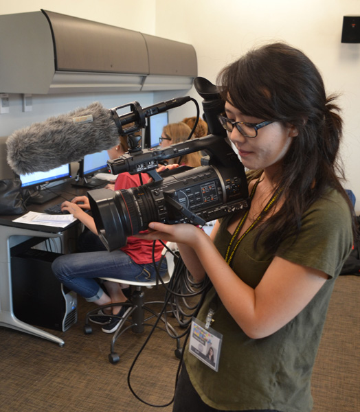 Video Editor and Mentor, Lindsey Rudd, films some students for the daily video.