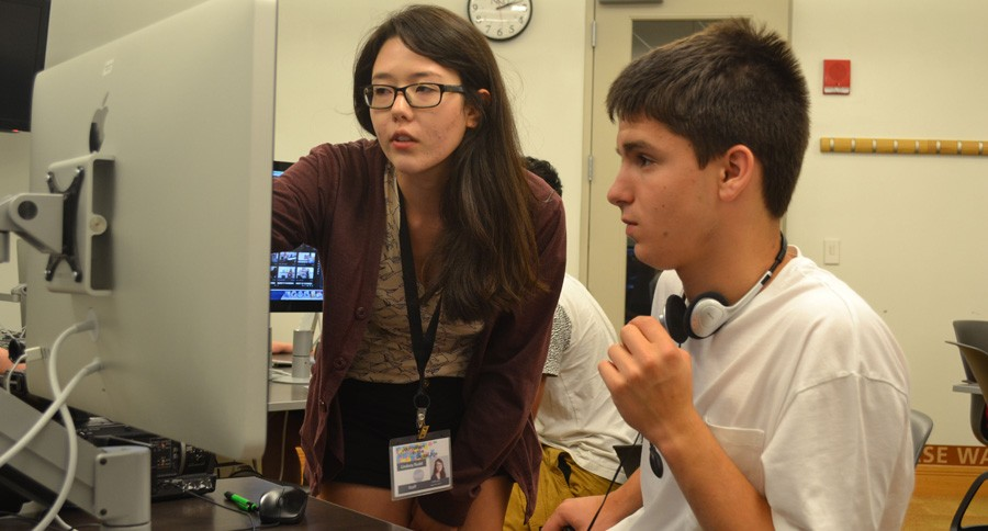 Mentor Lindsey Rudd gives tips to Charlie Goldsmith for edit his video.