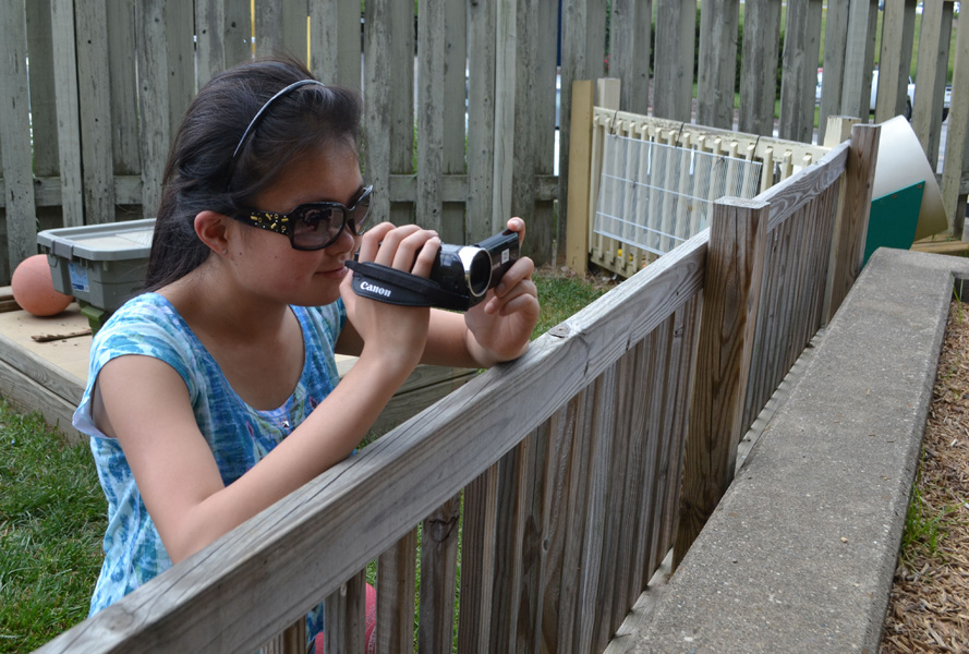 Mari Froude films children at the daycare.