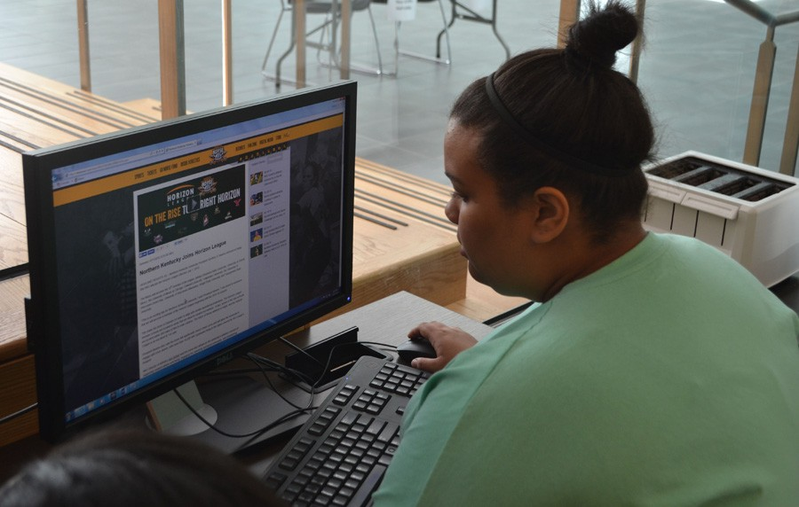 Rachel Daddieh researches the NKU Women's Basketball team for her story.