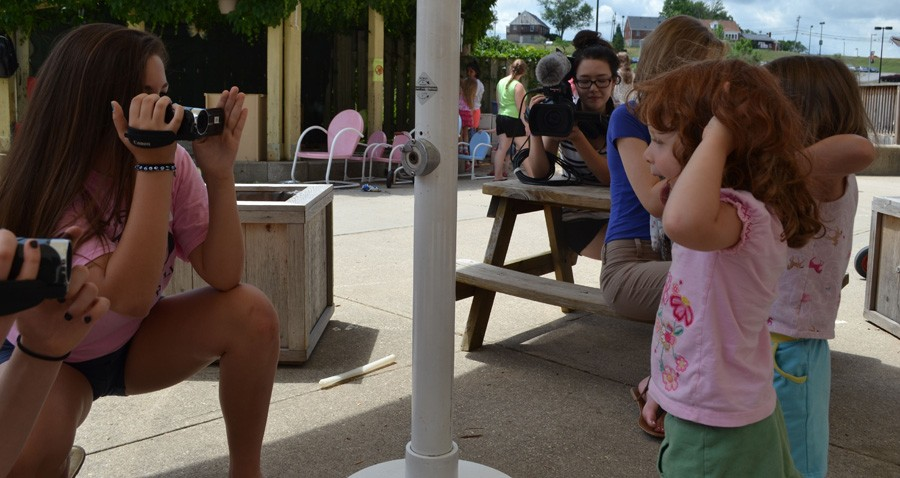 Sara Ruberg gets a close up of some silly faces at the daycare.