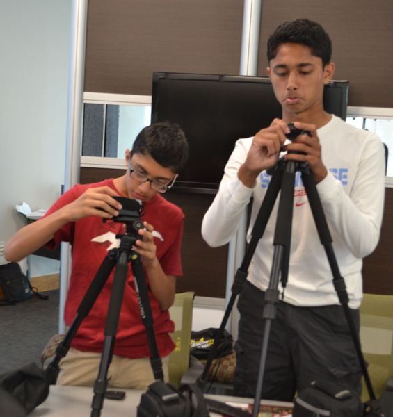 Shane Setna and Shubrath Shetty work on setting up their tripods.