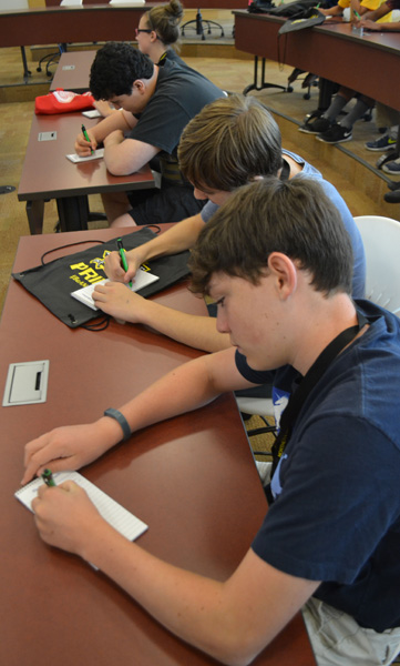 Steven Richter, Jake Huseman, and Amilcar Torres-Enrique takes notes of Michelle's interview tips.