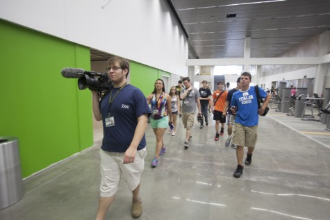 Video Editor Brian Murray leads the workshop students to the Rec Center to take photographs