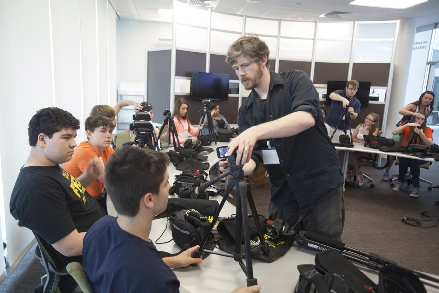 Video Instructor John Gibson teaches the students set their cameras on their tripods