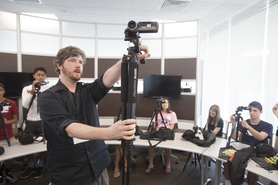 John Gibson shows the students the power of the tripod.