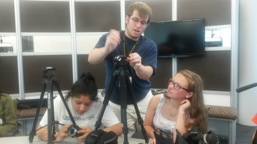 Brian Murray, a video mentor, shows workshop participants the ins and outs of camera tripod use.