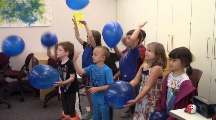 Students in the early childhood education center release balloons.