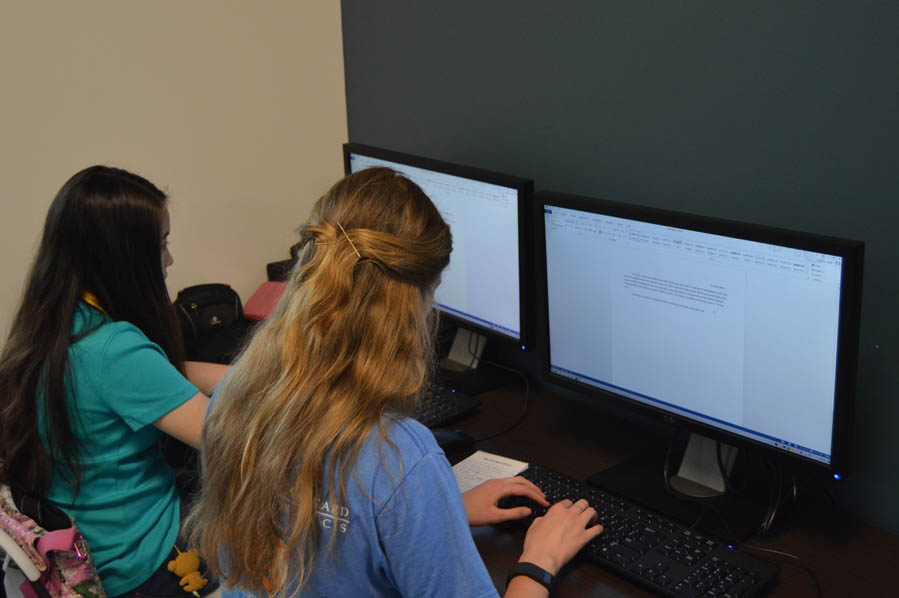 Tricia Gullett and Lina Kavall working on their follow ups.