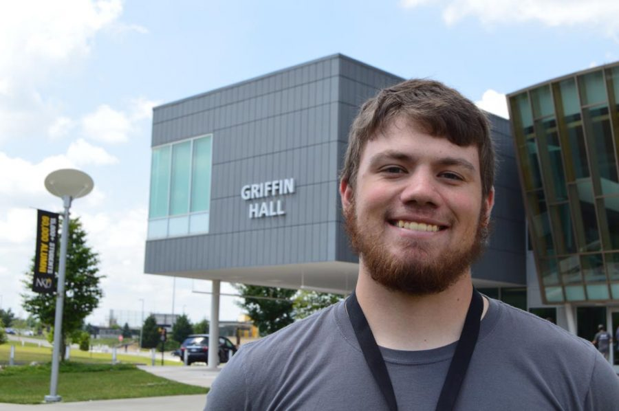 Mentor, Christopher Decker, posing for a photo outside of Griffin Hall