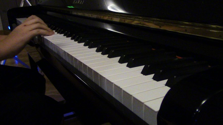 Nathan plays a tune on the piano