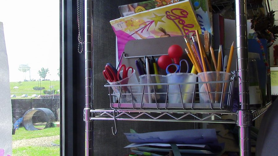 The kid's school supplies  by the window.