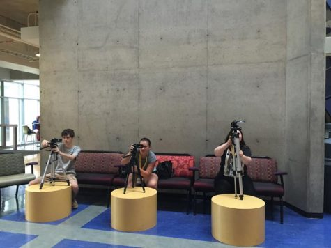 (left) Collin Trissel, (middle) Kaeleigh Taylor, (right) Sophia Spivey, all setting up their camera