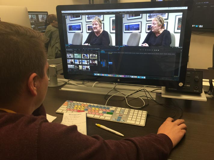 Kyle Kruthoffer editing a video using Adobe Primer Pro, the industry standard in video editing software.
