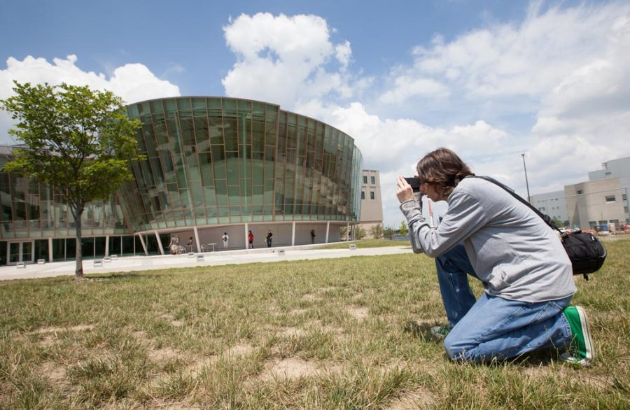Jw Story taking a picture of Griffin Hall