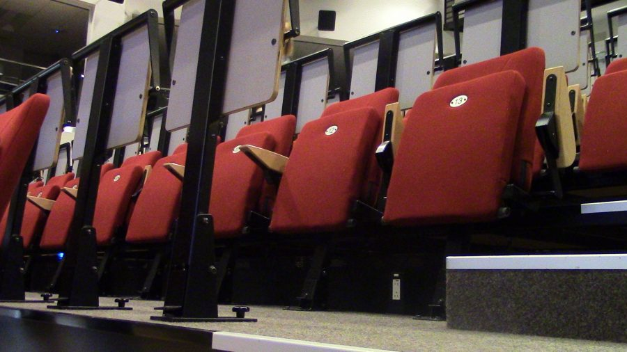 The seating of The Digitorium, a world class theater with a screen fitting the entire wall