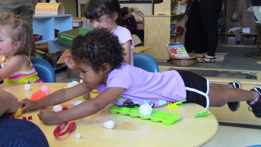Mia and Christina play with their blocks after lunch.