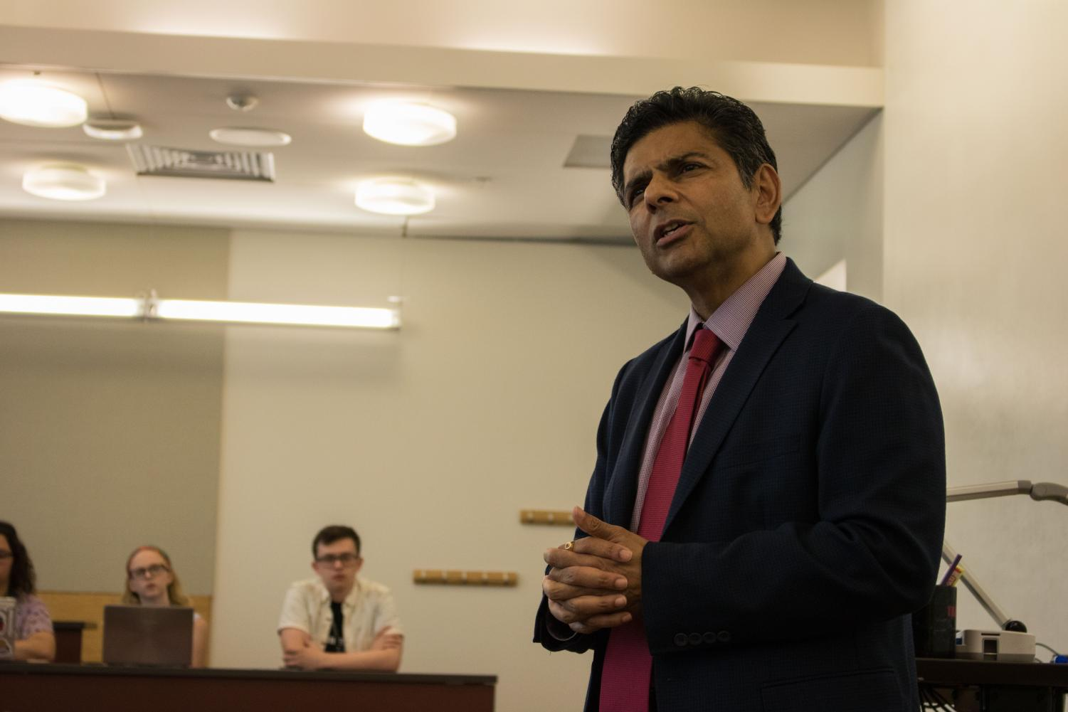 Vaidya+focused+on+campus+growth%2C+financial+challenges+and+his+career+in+academia+during+the+mock+press+conference.