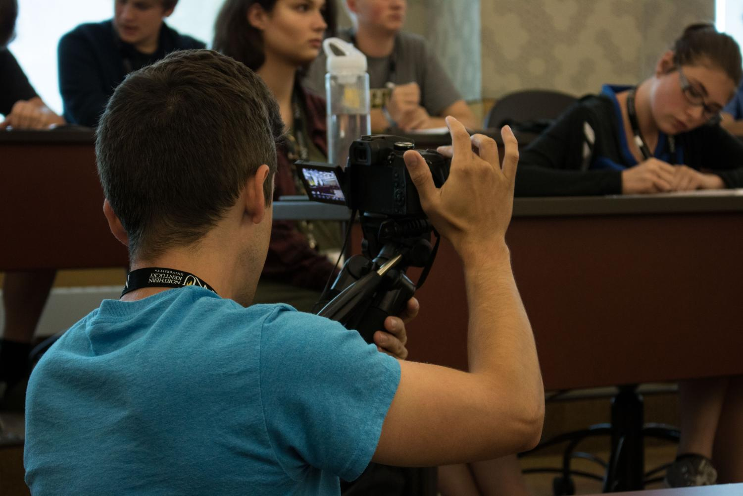 Mentor+Jarred+Clifton+shoots+video+of+the+afternoon+press+conference.