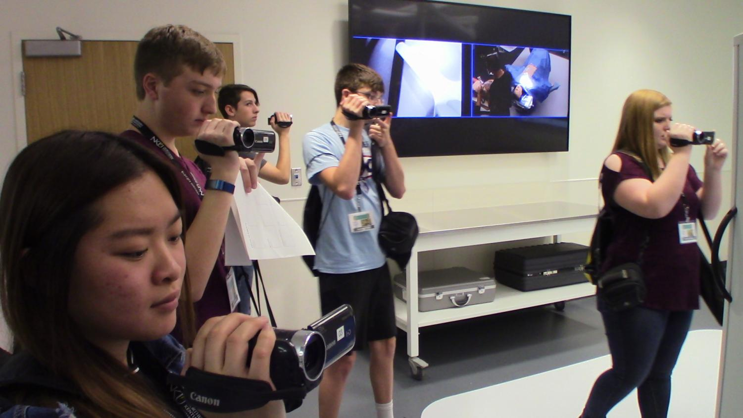 Students+film+B-roll+in+the+Health+Innovations+Center.