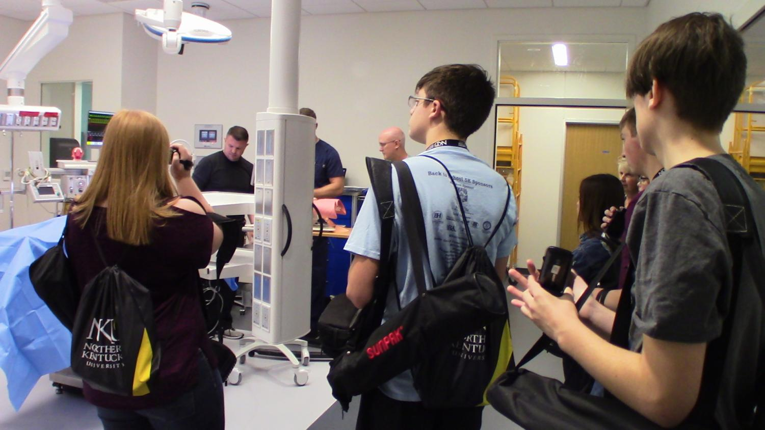 Students+take+turns+asking+questions+during+an+interview+at+the+Health+Innovations+Center.