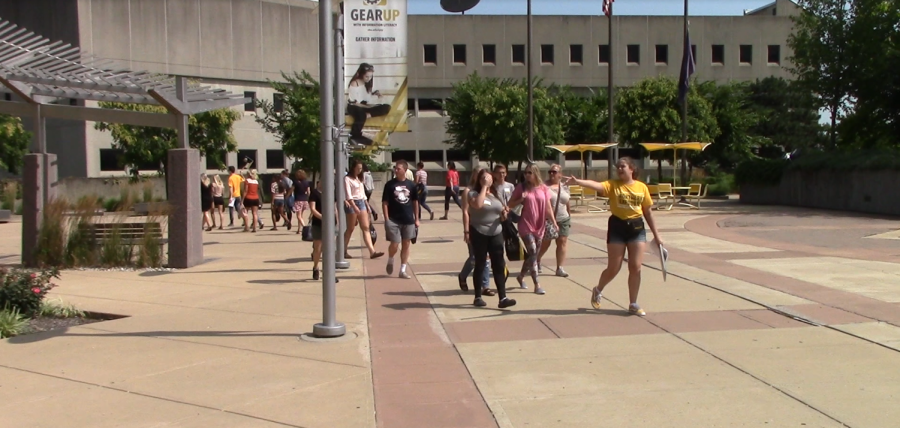 Students walking through campus as part of campus orientation.
