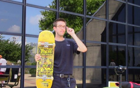 Chris Fenton-Wells poses with his board.