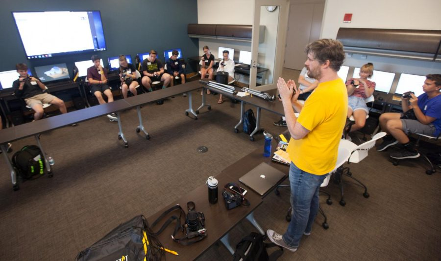 Video Director John Gibson teaches students how to operate their cameras they were assigned for the week.